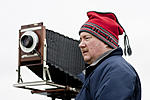 Click image for larger version.  Name:Tillman Crane photographing near Fillmore, ND 2010 workshop - Photo by Dan Smith.jpg Views:8 Size:43.4 KB ID:177134